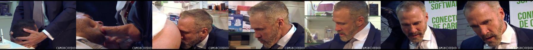 Przystojny facet w garniturze pierdoli sprzedawcę w sklepie z elektroniką